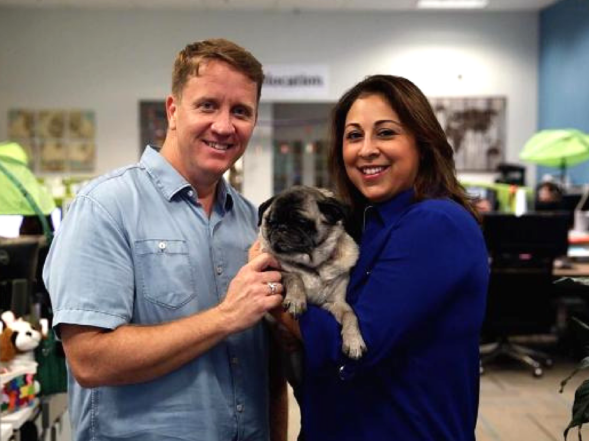 PetRelocation owners, Kevin and Angie holding a dog.